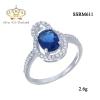 แหวนทองคำขาว ประดับเพชร CZ แหวนพลอยทรงรูปไข่สีน้ำเงิน ล้อมรอบฝังเพชรกลมขาว ช่วงบ่าฝังเพชรเรียงแถว ดีไซน์หรูดูภูมิฐานใส่ได้ตลอดเวลา